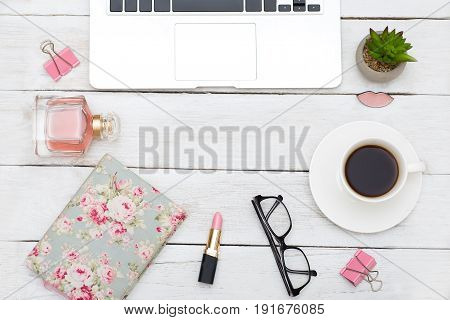 Feminine objects and electronic devices on white wooden background. flat lay