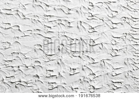 Relief white background, decorative stucco surface, plastered wall texture. Backdrop with free space for text.