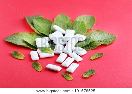 Chewing Gums With Mint Leafs On Red Background
