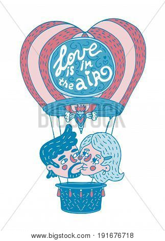 Young couple kissing on a hot baloon with lettering phrase