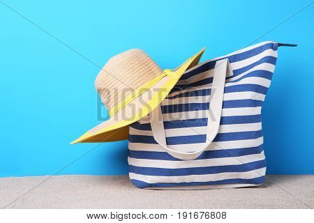 Blue Summer Bag With Hat On Beach Sand