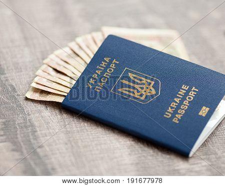 hryvnia in the Ukrainian passport. Ukrainian money in international biometric passport.