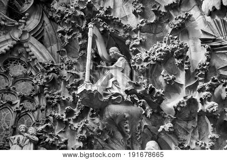 Architectural Cathedral Details of a Woman playing the Harp, in Barcelona Spain.