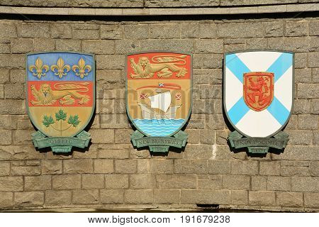 Victoria BC,Canada,September 9th 2014.Coats of arms for the Canadian provinces of Quebec,New Brunswick and Nova Scotia hang on a wall in Victoria.