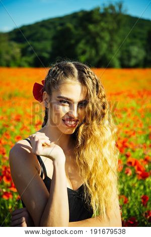 Poppy Seed And Girl With Long Curly Hair