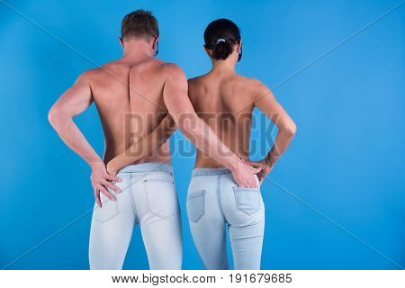 Young Couple Of Man And Woman Embrace In Stylish Jeans