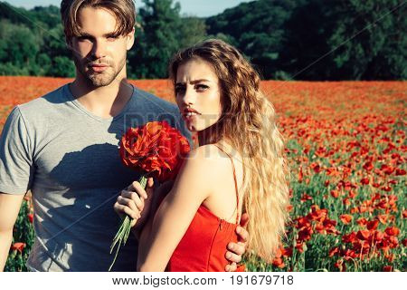 Man And Girl With Flower Bouquet In Red Poppy Field