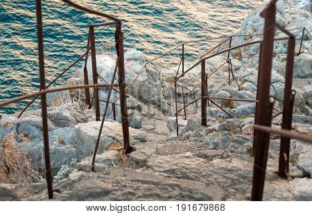 Crimea the rock Diva. A path to the top. Slippery stone steps and rusted metal handrails