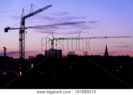 Crane on a construction site at night
