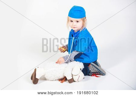 Doctor Kid In Uniform Playing Vet With Toy Animal