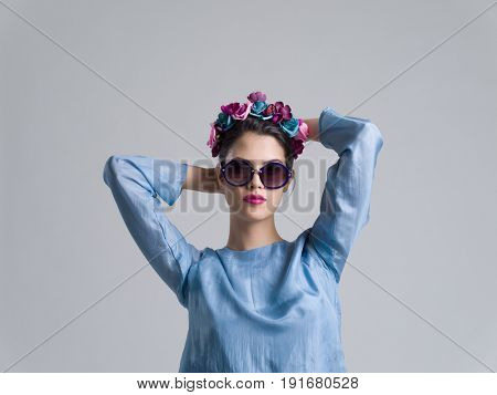 Fashion Model girl isolated over white background. Beauty stylish woman posing in fashionable clothes and sunglasses. Casual style with beauty accessories. High fashion urban style