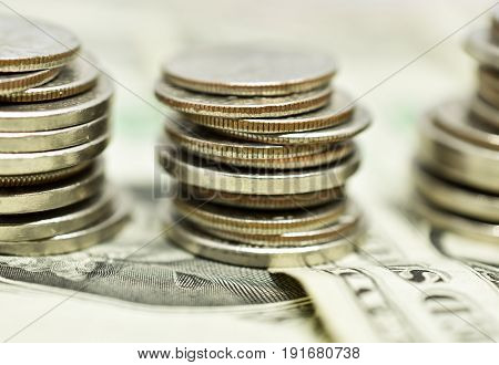 Close up of money - coins stacked on bills