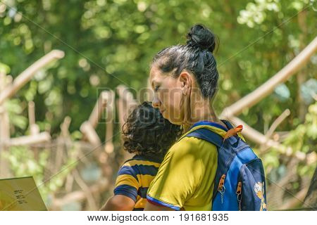GUAYAQUIL, ECUADOR, MAY - 2016 - Mother and son at historic park zoo located at samborondon neighborhood Guayaquil Ecuador