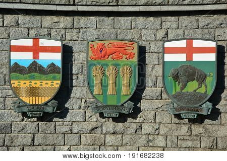 Victoria BC,Canada,March 3rd 2015..Coats of arms for the Canadian provinces of Saskatchewan,Manitoba and Alberta hang on a wall in Victoria
