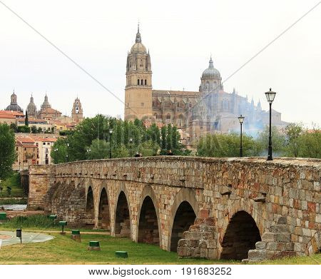 Beautiful view of ascent romanian bridge and Cathedral of Salamanca, Spain