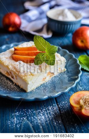 Dessert Made Of Two Puff Pastry Layers Filled With Mascarpone Cream And Nectarine