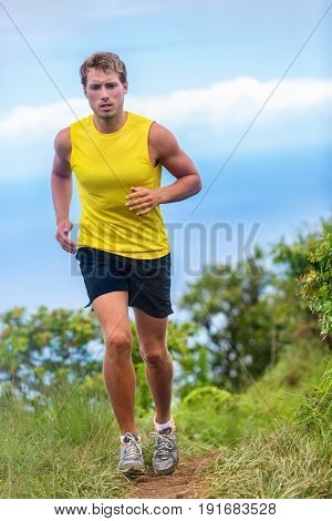 Ultra running man athlete runner on trail run in nature mountains. Endurance sports healthy active lifestyle. Fitness motivation.