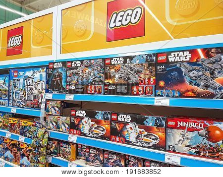 Nowy Sacz Poland - June 16 2017: Lego construction kits for sale in the Tesco supermarket. Lego is a line of plastic construction toys that are manufactured by The Lego Group company in Denmark.