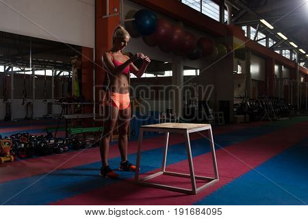 Woman Working Out With Fit Box At Gym