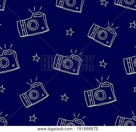 Summer pattern with camera and stars. Ornament for textile and wrapping. Vector background.