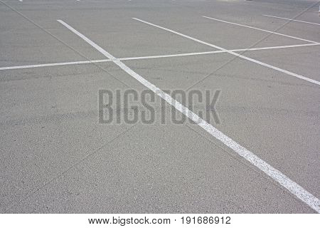 White Lines Of Marking On A Background Of Gray Asphalt Parking