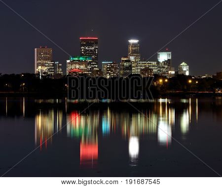 Minneapolis Skyscrapers Reflecting In Lake Calhoun At Night