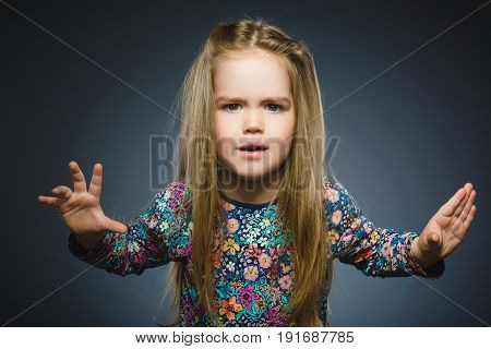 angry girl isolated on gray background. Negative human emotion, facial expression. Closeup.