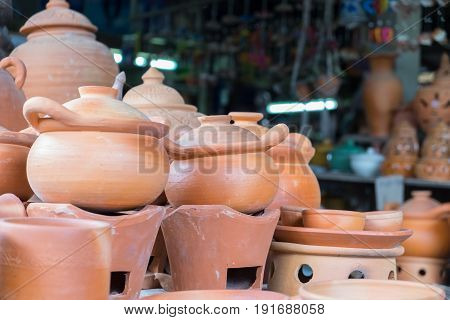 Earthenware brown handmade clay pots, handmade wallpaper