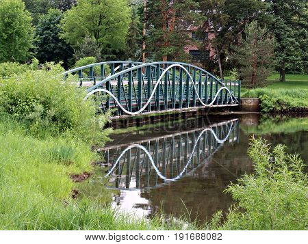 Footbridge Reflecting in Pond in Minneapolis Park
