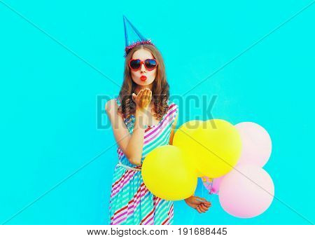 Beautiful Woman In A Birthday Cap Is Sends An Air Kiss Holds An