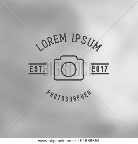 Logo for photographer with thin line icon of camera. Minimalistic simple vector illustration.