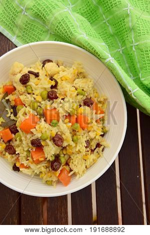 Homemade vegetable biryani with raisins, Indian cuisine