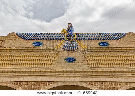 YAZD, IRAN - MAY 5, 2015: Faravahar mosaic symbol on Zoroastrian fire temple Atash Behram in old city.