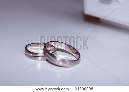 wedding rings isolated on white ground .
