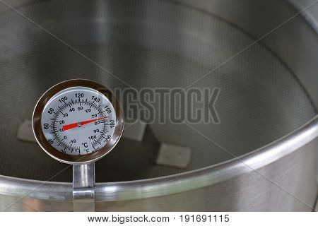 Dial Thermometer in Heating Water for Beer