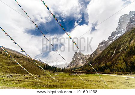 View on Tibetan Prayer Flags in mountain landscape of CHINA