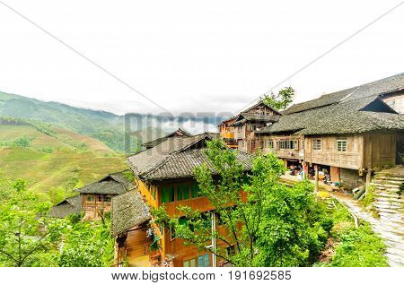 View on Traditional chinese wodden house in the rice fields by Longsheng