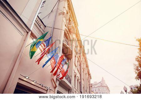 Flags of russia, united states, brazil, turkey, china, european union, iran on embassy house