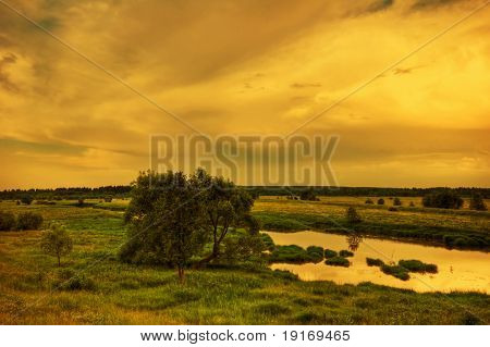 Sunset in the summer field poster