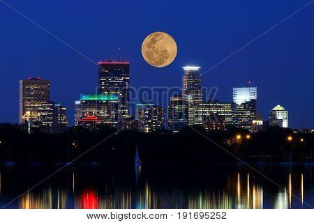 Moon over Minneapolis with Lights Reflecting in Lake Calhoun