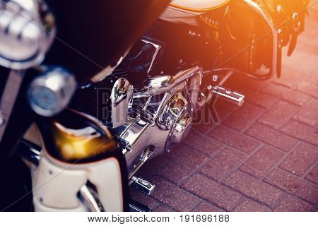 Motorcycle luxury items close-up: headlights, shock absorber, wheel, wing, toning. Concept travel on two wheels.