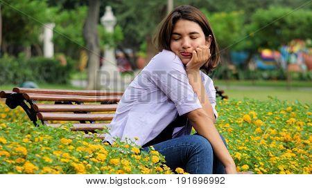 Tired Pretty Teen Female Sitting On Bench