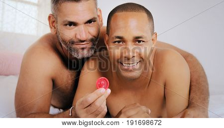 Gay Couple Homosexual Couple Men Showing Condom For Safe Sex