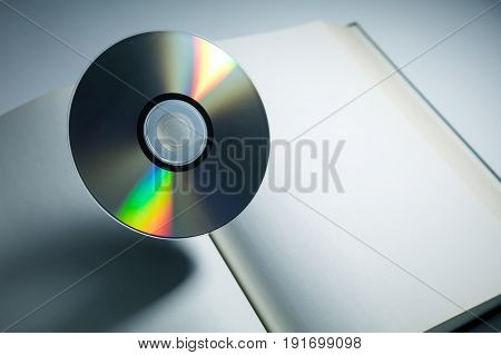Book and DVD disk with dark shadow education concept.