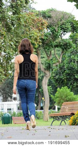 Beautiful Person Wearing Blue Jeans Walking In Park