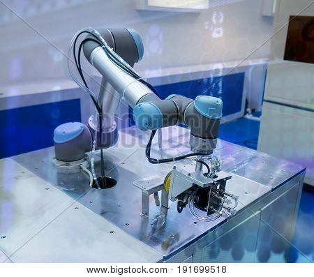 robot arm working in phone factory