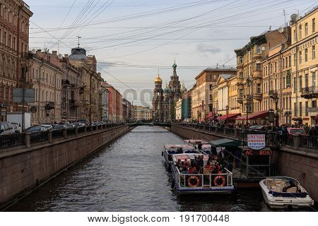 Saint Petersburg, RUSSIA - MAY 30, 2017: River channel with boats, embankment and Church of the Resurrection (Savior on Spilled Blood). Saint Petersburg