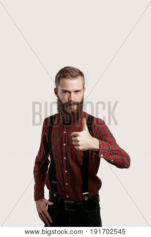 Good job. You right. Like concept. Stylish beard man in red shirt show yes. Portrait of attractive manshow thumb up. Endorsing concept.