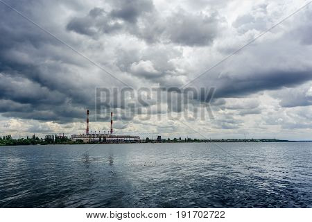 Power electricity station or factory with pipes on a river In Voronezh in cloudy day