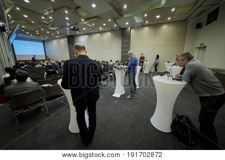 MOSCOW, RUSSIA - APR 25, 2017: Conference participants in auditorium during AI Conference in Novotel Moscow City Hotel. Conference is devoted to introduction of artificial intelligence in business.